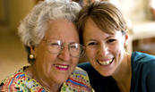 senior woman smiling with a volunteer